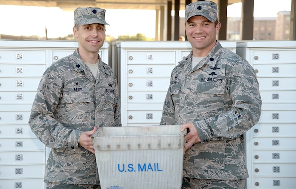 Lt. Col. Hart (left), commander, 802nd Force Support Squadron, and Lt. Col. Robert G. Giovannetti (right), 502nd Communications Squadron, pose outside the student mail center at Joint Base San Antonio-Fort Sam Houston Nov. 27 after JBSA postal operations transferred to the direction of the 802d FSS. They had been a part of the 502nd Communications Squadron since 1993 and will be realigned under the 802nd FSS.