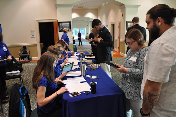 IMAGE: Members of Naval Surface Warfare Center Dahlgren Division's Human Resources team check-in potential employees during the 2017 Winter Job Fair at the Fredericksburg Expo and Conference Center, Nov. 28.