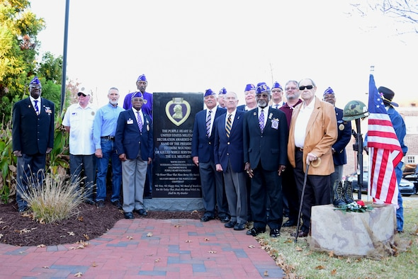 Recipients of the Purple Heart medal gather in front of the newly unveiled Purple Heart memorial Nov. 29, 2017, at the Wayne County Veteran's Memorial, Goldsboro, North Carolina.
