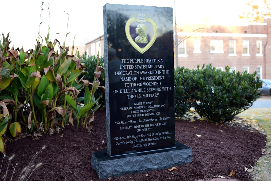 A Purple Heart memorial monument is presented during the Purple Heart memorial dedication ceremony Nov. 29, 2017, at the Wayne County Veteran's Memorial, Goldsboro, North Carolina.