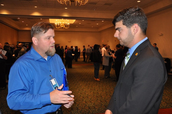 IMAGE: A representative from Naval Surface Warfare Center Dahlgren Division speaks with a potential employee during the 2017 Winter Job Fair at the Fredericksburg Expo and Conference Center, Nov. 28.