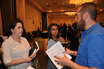 IMAGE: A representative from Naval Surface Warfare Center Dahlgren Division speaks with potential employees during the 2017 Winter Job Fair at the Fredericksburg Expo and Conference Center, Nov. 28.