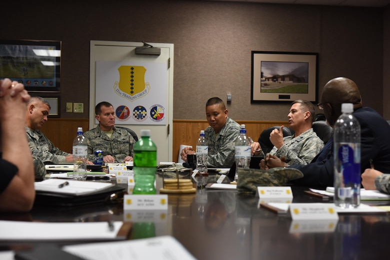 U.S. Air Force Lt. Col. Scott Jensen, Cyberspace Capabilities division chief, speaks during a meeting in the Brandenburg Hall on Goodfellow Air Force Base, Texas, Nov. 29, 2017. Jensen visited on behalf of Air Education Training Command to discuss how to increase the bases network speeds. (U.S. Air Force photo by Airman 1st Class Zachary Chapman/Released)