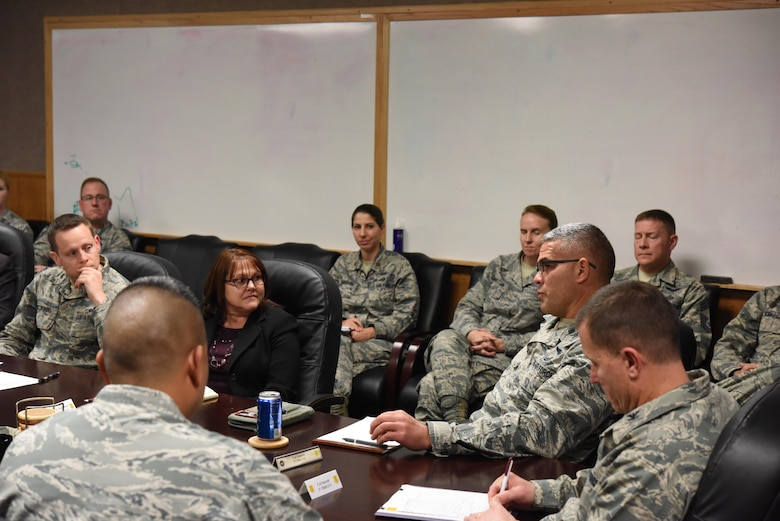 Ms. Linda Halverson, Air Combat Command Air Force Distributed Common Ground System Weapons System Team chief, listens as U.S. Air Force Col. Alejandro Ganster, 17th Training Group commander, speaks during a meeting in the Brandenburg Hall on Goodfellow Air Force Base, Texas, Nov. 29, 2017. Halverson, as part of Air Combat Command, ended her visit with a meeting about increasing the base's network speeds. (U.S. Air Force photo by Airman 1st Class Zachary Chapman/Released)