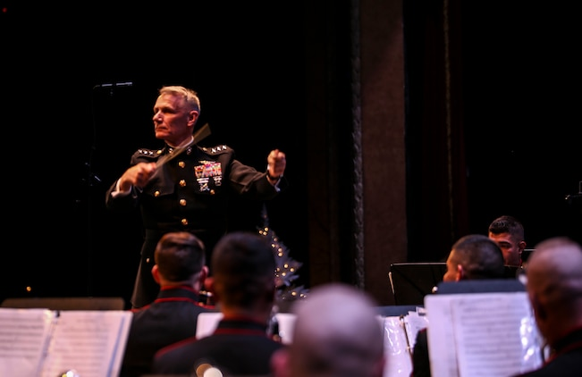 "Lt. Gen. Rex C. McMillan, commander of Marine Forces Reserve, takes charge of conducting the Marine Corps Band New Orleans during their ""Santa Meets Sousa"" holiday concert at Saenger Theater in New Orleans on Dec. 11, 2015."