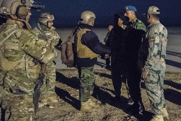 An Afghan Air Force leader meets with Special Tactics Airmen from the Air Force Special Operations Command to discuss plans to increase airpower at airfields in Faryab province, Afghanistan, Nov. 29, 2017. The Special Tactics airmen ensure access to traditional airfields and field landing strips to increase the operational reach of coalition and Afghan aircraft for reconnaissance, troop delivery, and strategic air support operations. (U.S. Air Force photo by Staff Sgt. Doug Ellis)