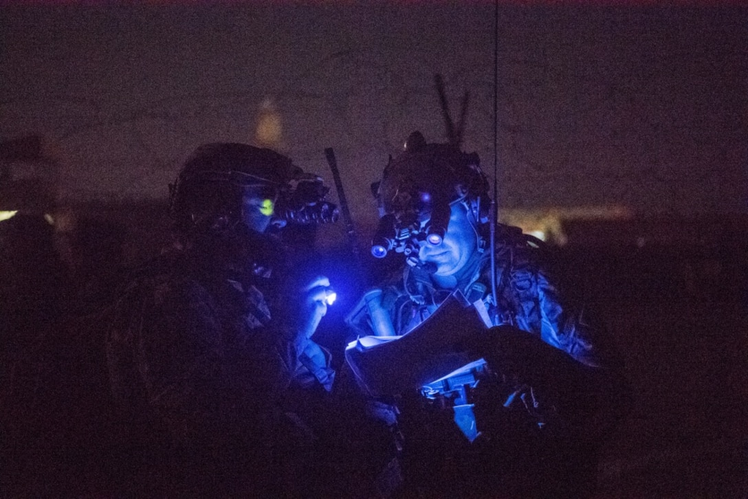 U.S. Airmen with the Air Force Special Operations Command discuss results of an airfield survey during operations in Faryab province, Afghanistan, Nov. 29, 2017. The Special Tactics Airmen ensure access to traditional airfields and landing strips to increase the operational reach of coalition and Afghan aircraft for reconnaissance, troop delivery and strategic air support operations. (U.S. Air Force photo by Staff Sgt. Doug Ellis)