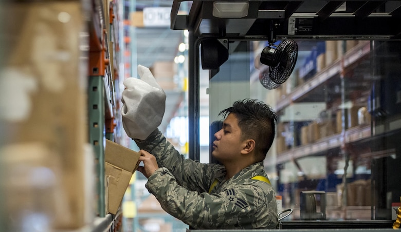 Senior Airman Nicoli Martin Leuterio, 366th Logistics Readiness Squadron material management journeyman, checks over a package at Mountain Home Air Force Base, Idaho, Nov. 29, 2017.