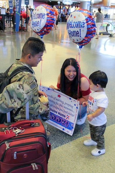 Senior Airman Nicoli Martin Leuterio's, 366th Logistics Readiness Squadron material management journeyman, family welcomes him home at the Boise Airport in Boise, Idaho.