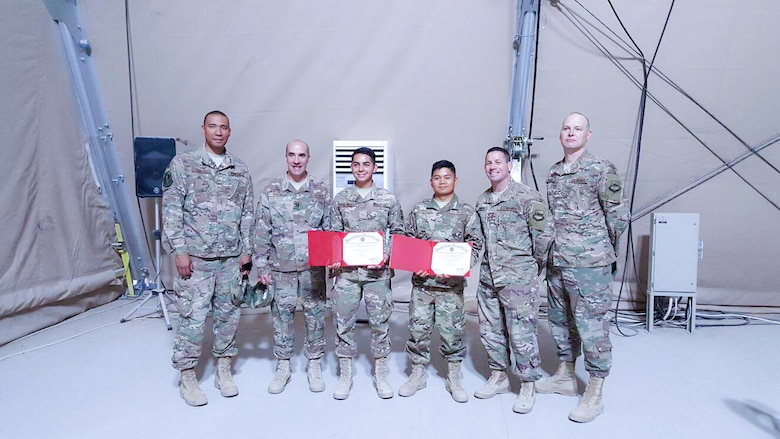 Senior Airman Nicoli Martin Leuterio, 366th Logistics Readiness Squadron material management journeyman, poses for a photo with his leadership during his deployment to Southwest Asia.
