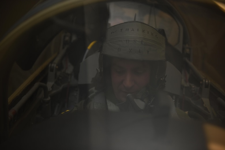 US Air Force Tech. Sgt. Joshua Cantrell, a dedicated crew chief assigned to the 131st aircraft maintenance squadron practices ejection procedures in a simulator aircraft Nov. 21, 2017 at Whiteman Air Force Base, Missouri. Flyers must demonstrate their knowledge of ejection procedures to a training instructor before flying in an aircraft.