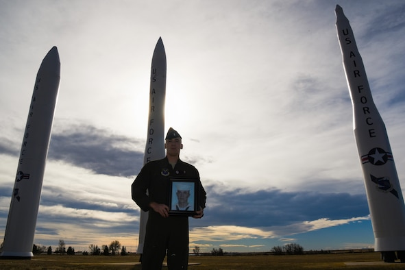 1st Lt. Tyler Lindquist, 320th nuclear and missile crew commander, holds a picture of Medal of Honor recipient Marvin Glenn Shields at F.E. Warren Air Force Base, Wyo., Nov. 29, 2017. Shields created a lasting impact on Lindquist as his great uncle, which resulted in his choice to serve a career within the U.S. Air Force. (U.S. Air Force photo by Airman 1st Class Abbigayle Wagner)