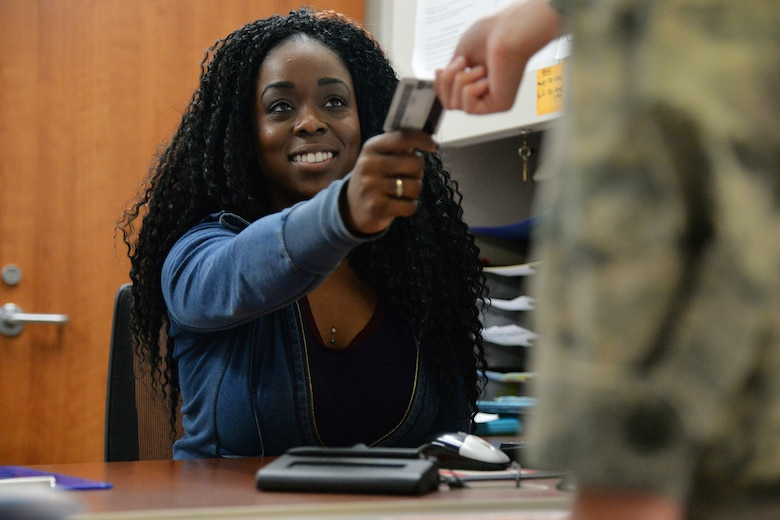 Jazmyn Steele, 341st Medical Operations Squadron family health clinic medical administration technician, greets an Airman at check in Nov. 27, 2017, at Malmstrom Air Force Base, Mont.