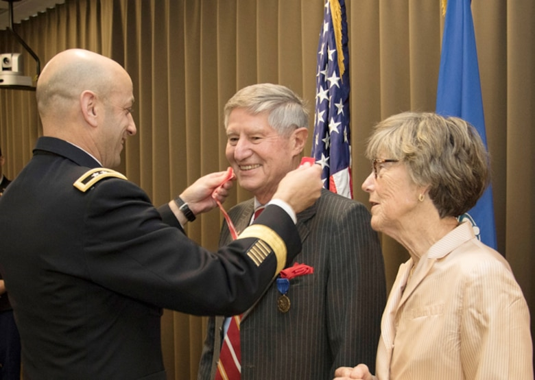 Dr. James Hearn, with wife Lauren is presented the the Bronze DeFluery Medal by Northwestern Division Commander, Maj. Gen. Scott A. Spellmon. Dr. Hearn retires after more then 30 years of federal service including the last 8 years with the Northwestern Division.