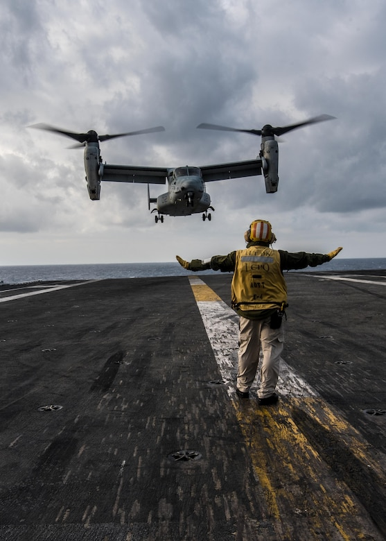 An MV-22B Osprey of Marine Medium Tiltrotor Squadron (VMM) 265 lands on the flight deck of the Navy's forward-deployed aircraft carrier, USS Ronald Reagan (CVN 76). Ronald Reagan, the flagship of Carrier Strike Group 5, provides a combat-ready force that protects and defends the collective maritime interests of its allies and partners in the Indo-Asia-Pacific region.