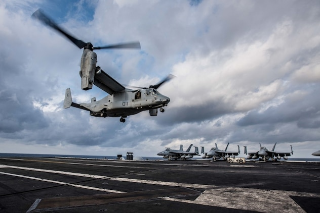 171127-N-CL027-038 PHILIPPINE SEA (Nov. 27, 2017) An MV-22 Osprey of Marine Medium Tiltrotor Squadron (VMM) 265 lands on the flight deck of the Navy's forward-deployed aircraft carrier, USS Ronald Reagan (CVN 76). Ronald Reagan, the flagship of Carrier Strike Group 5, provides a combat-ready force that protects and defends the collective maritime interests of its allies and partners in the Indo-Asia-Pacific region. (U.S. Navy photo by Mass Communication Specialist 2nd Class Janweb B. Lagazo)