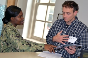 Petty Officer 1st Class Jalisa Green, a recruiter assigned to Navy Recruiting Station Corpus Christi, Navy Recruiting District San Antonio, speaks with future Sailor Oleksandr Omelchemko regarding his career choice at the Military Entrance Processing Station.