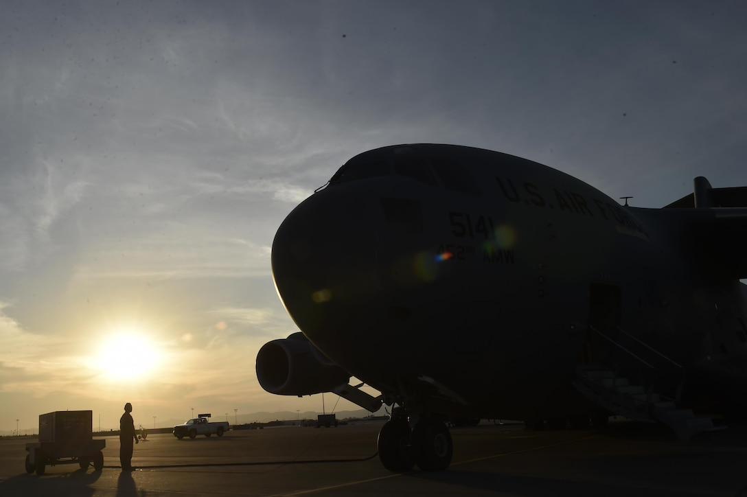 U.S. Air Force Tech. Sgt. Matthew Hamilton, 452nd Aircraft Maintenance Squadron crew chief, performs a pre-flight check on a C-17 Globemaster aircraft, at Travis Air Force Base, Calif., Sept. 30. The aircraft from March Air Reserve Base, Calif., will deliver a 65-member Contingency Response Element to Aguadilla, Puerto Rico to establish command and control of the airfield and provide aerial port and maintenance support during Hurricane Maria relief efforts.  (U.S. Air Force photo by Tech. Sgt. Liliana Moreno/Released)