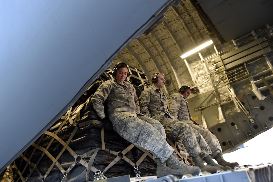 Aerial porters load cargo onto a C-17 Globemaster III aircraft in preparation for Hurricane Maria relief efforts, Sep. 30, 2017, at Travis Air Force Base, Calf. The aircraft from March Air Reserve Base, Calif., will deliver a 65-member Contingency Response Element to Aguadilla, Puerto Rico to establish command and control of the airfield and provide aerial port and maintenance support during Hurricane Maria relief efforts.  (U.S. Air Force photo by Tech. Sgt. Liliana Moreno/Released)