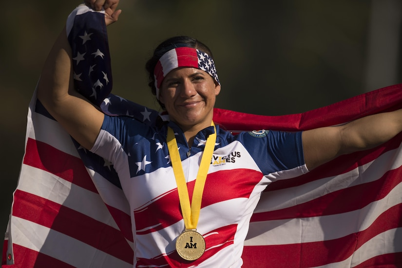 Medically retired Air Force Staff Sgt. Sebastiana Lopez-Arellano reacts to winning a gold medal for hand cycling during the 2017 Invictus Games in Toronto, Sept. 26, 2017. DoD photo by EJ Hersom