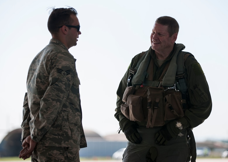U.S. Air Force Gen. Robin Rand, Air Force Global Strike Command commander, speaks with Senior Airman Samuel Daniels, 80th Air Maintenance Squadron crew chief, before his flight in an F-16 Fighting Falcon at Kunsan Air Base, Republic of Korea, Sept. 28, 2017. Rand, a former 8th Fighter Wing commander affectionately known as Wolf 42, reconnected with the base and the mission through visits with Airmen, base leadership, and spoke to the important role that both AFGSC and the Wolf Pack play in supporting the Korean peninsula and pacific region. (U.S. Air Force photo by Staff Sgt. Victoria H. Taylor)