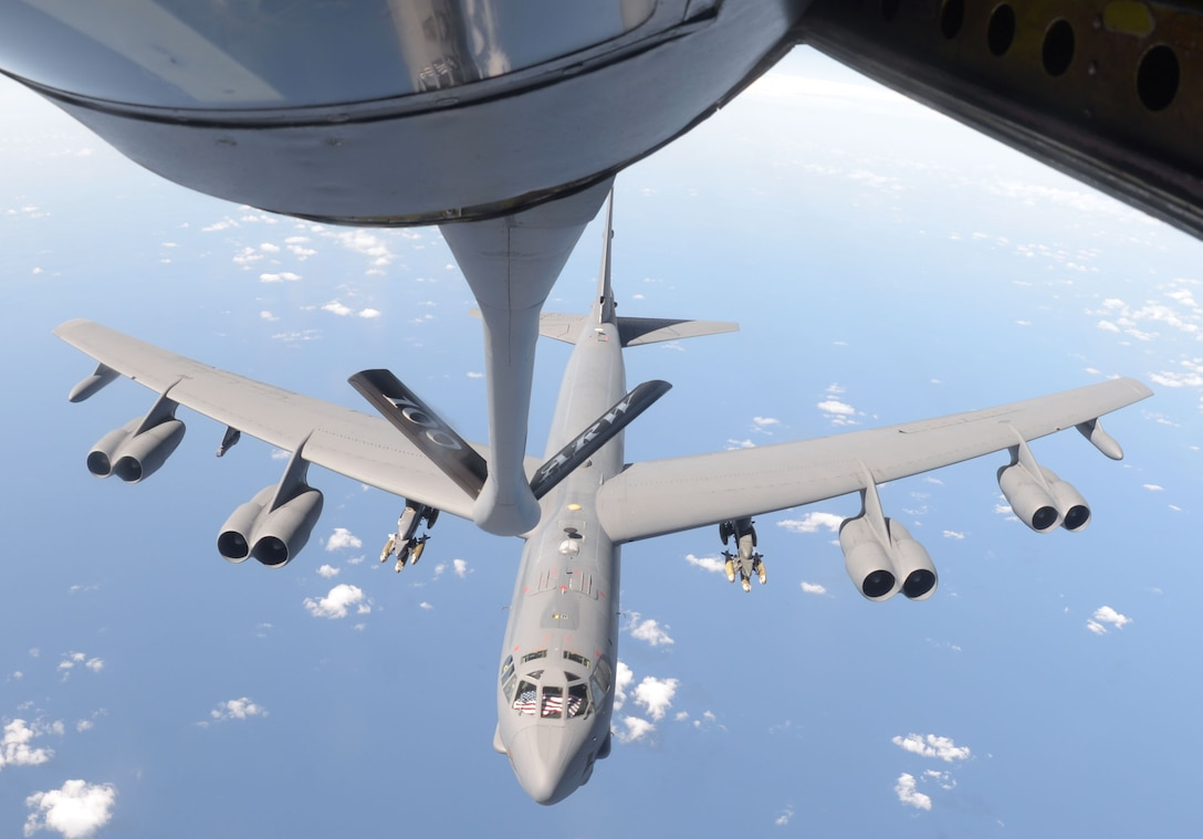 A U.S. Air Force B-52 Stratofortress from Barksdale Air Force Base, La, moves away from a KC-135 Stratotanker from RAF Mildenhall, England, after refueling Sept. 27, 2017, over the Mediterranean Sea. Part of the B-52's training during its deployment includes releasing inert ordnance while flying over controlled airspace areas of the Netherlands and the United Kingdom.  (U.S. Air Force photo by Airman 1st Class Benjamin Cooper)