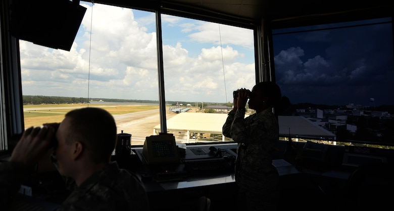 Senior Airman John Rode and Airman 1st Class Arafa Simmons, 81st Operations Support Flight air traffic controllers, look for incoming aircraft in the air traffic control tower Sept. 18, 2017, on Keesler Air Force Base, Mississippi. The air traffic controllers are responsible for approving the taxi, tow, departure and landing of aircraft as well as giving approval for personnel on the ground to access the airfield. The 81st OSF is responsible for all air operations. (U.S. Air Force photo by Airman 1st Class Suzanna Plotnikov)