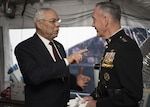 Army Gen.Colin L. Powell, (Ret.) speaks with Marine Corps Gen. Joseph F. Dunford Jr., chairman of the Joint Chiefs of Staff, before the National Memorial Day Concert at the west lawn of the U.S. Capitol, Washington, D.C., May 28, 2017.