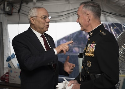 Army Gen.Colin L. Powell, (Ret.) speaks with Marine Corps Gen. Joseph F. Dunford Jr., chairman of the Joint Chiefs of Staff, before the National Memorial Day Concert at the west lawn of the U.S. Capitol, Washington, D.C., May 28, 2017. The concert's mission is to unite the country in remembrance and appreciation of the fallen and to serve those who are grieving. (Dept. of Defense photo by Navy Petty Officer 2nd Class Dominique A. Pineiro/Released)