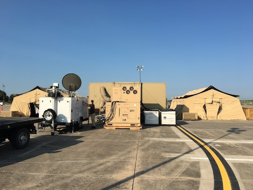 Robert Garcia is inspecting the communications gear at the FEMA Incident Support Base at Randolph Air Force Base.