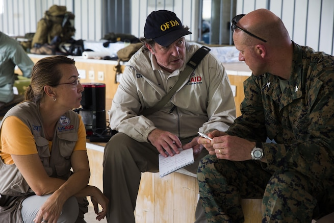 U.S. officials discuss humanitarian assistance and disaster relief operations in Roseau, Dominica.