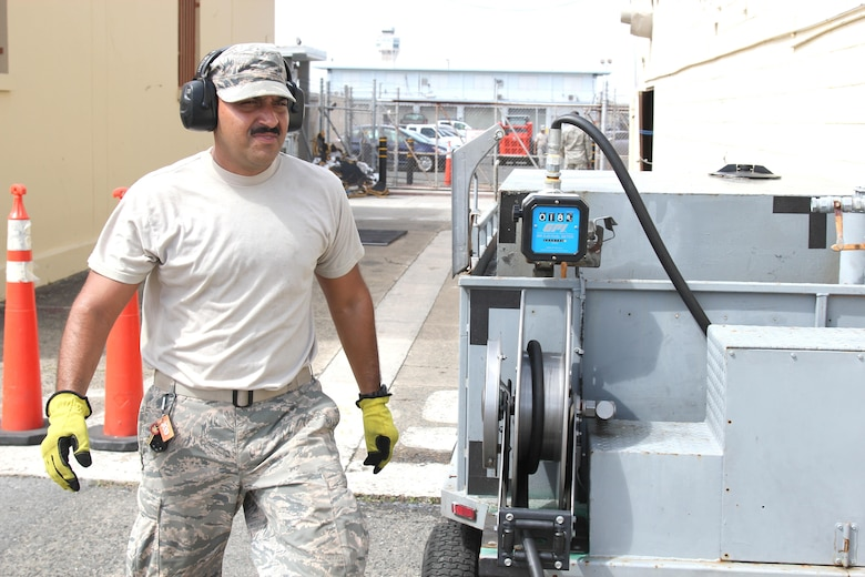 Airman 1st Class Pedro Pedraza and Staff Sgt. Carlos Arroyo travel to a generator location at Muniz Air National Guard Base, Oct. 1, 2017. The two Airmen are members of the Puerto Rico Air National Guard and are working to keep the generators running at the air base. The Puerto Rico Air National Guard is working with many federal and local agencies in response to the damage caused to Puerto Rico by Hurricane Maria, which hit the island territory on Sept. 20, 2017. (U.S. Air National Guard photo by Tech. Sgt. Dan Heaton)