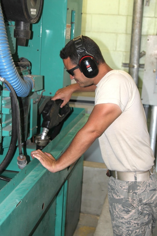 Staff Sgt. Carlos Arroyo, a power production specialist with the 156th Civil Engineer Squadron, works on refueling a generator at Muniz Air National Guard Base, Oct. 1, 2017. The Puerto Rico Air National Guard is working with many federal and local agencies in response to the damage caused to Puerto Rico by Hurricane Maria, which hit the island territory on Sept. 20, 2017. (U.S. Air National Guard photo by Tech. Sgt. Dan Heaton)