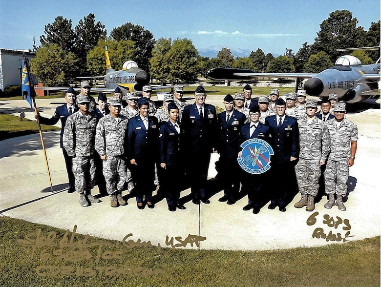 Current and legacy members of the 6th Space Operations Squadron came together for a photo during Chief Master Sgt. Paul Rayman's retirement ceremony at the Peterson Air Force Base Air and Space Museum on Saturday, Sep. 9, 2017.