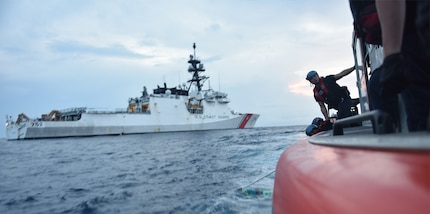 Coast Guard personnel recover jettisoned cocaine bales out of the Pacific Ocean