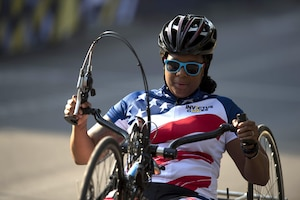 A woman uses a hand cycle.