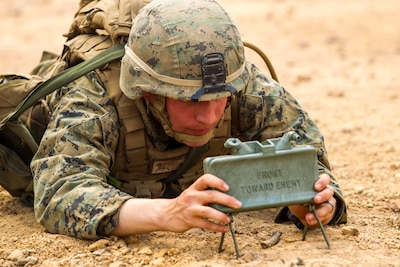 Marine sets up M18A1 claymore mine during Exercise Cobra Gold, February 14, 2014, at Ban Chan Krem, Kingdom of Thailand (U.S. Marine Corps/Adam Miller)