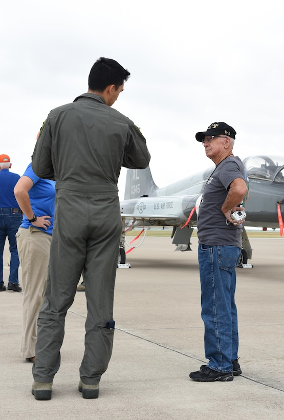 1st Lt. Dan Putney, 47th Student Squadron pilot, chats with James Ballard, former 4080th Strategic Reconnaissance Wing assistant crew chief, on the flightline at Laughlin Air Force Base, Texas, Sept. 22, 2017. Student pilots volunteered to lead tours to the flightline during the reunion.