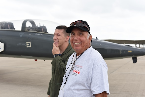 Fabian Fonseca, former 4080th Strategic Reconnaissance Wing armament and electronics for the U-2 Dragon Lady, socializes with 2nd Lt. Leslie Johnston IV, 47th Student Squadron pilot, on the flightline at Laughlin Air Force Base, Texas, Sept. 22, 2017. The 4080th SRW reunions are an opportunity for the Airmen of the 4080th SRW to relate to the Airmen currently stationed at Laughlin.