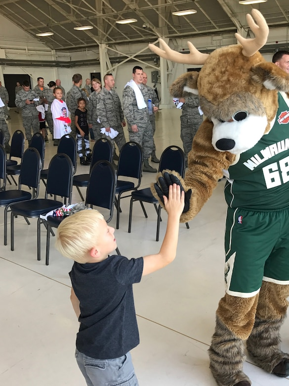 Airmen of the 115th Fighter Wing and their families were able to take a break together, at the end of the regularly scheduled drill day, Sept. 9 at Truax Field, Madison, Wisconsin to enjoy a visit from Milwaukee Bucks' Rashad Vaughn and the Rim Rockers and Hoop Troop, along with the Milwaukee Bucks Dancers and Bango, the Bucks mascot. (Photo Courtesy of 115th FW member).