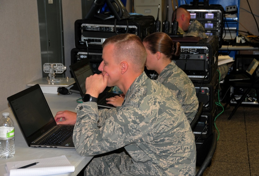 Capt. Jeff Rutkowski from the 115th Fighter Wing, Wisconsin Air National Guard, and members of his team work inside the Puerto Rico FAA Operations Center, Sept. 30, 2017. The Wisconsin Guardsmen established a JISCC to restore air traffic communications allowing the FAA to resume full operations. (U.S. Air National Guard Photo by Capt. Matt Murphy)