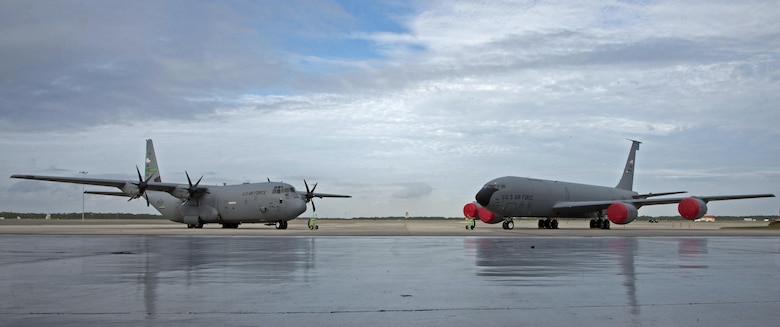 A C-130 Hercules aircraft and a KC-135 Stratotanker aircraft sit on the flightline during an assumption of command ceremony for the 50th Air Refueling Squadron (ARS) at MacDill Air Force Base, Fla., Oct. 2, 2017.