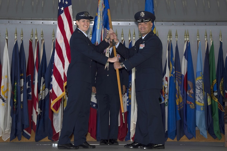 U.S. Air Force Lt. Col. Ricardo Lopez (right), commander of the 50th Air Refueling Squadron (ARS), accepts the guidon from Col. Lisa Nemeth, commander of the 6th Operations Group , at MacDill Air Force Base, Fla., Oct. 2, 2017.