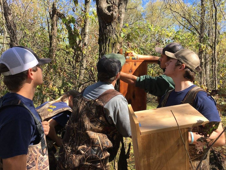 Students from Montgomery Center High School's Agriculture Academy install a wood duck box at Cheatham Lake in Ashland City, Tenn., Sept. 29, 2017 as part of National Public Lands Day activities. (USACE photo by Park Ranger Dean Austin)