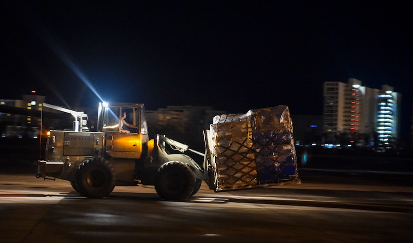 A pallet of food and water is offloaded at San Juan, Puerto Rico, Sept. 30th, 2017.