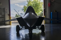 A model F-22 Raptor, refurbished and restored by the 60th Maintenance Squadron fabrication flight, is parked inside Building 803 to be delivered to recruiters with the 364th Recruiting Squadron Sept. 21 from McCellan Air Force Base, Calif. The model F-22 has brought the 60th MXS team closer together as many volunteers worked together in completing the refurbishment.