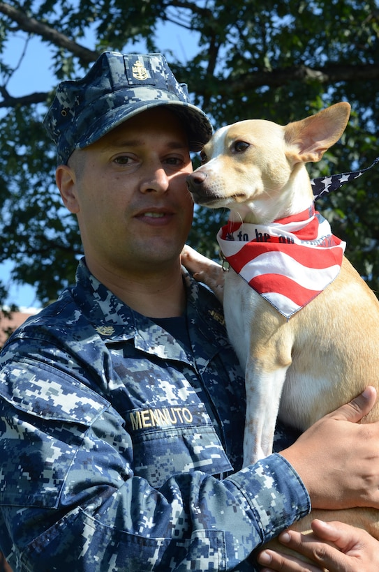 Photo of Navy Chief Petty Officer Daniel Mennuto and his dog Moscato.