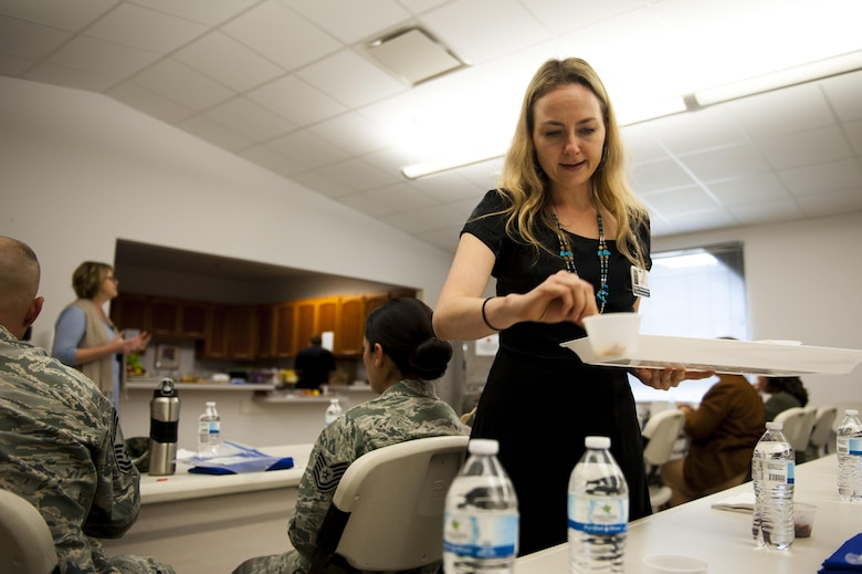 Karina Kislitsyna, San Angelo Community Medical Center chef assistant, hands out food to visitors during a food demonstration at the Taylor Chapel on Goodfellow Air Force Base, Texas, Sept. 26, 2017. The food was prepared and cooked by Marc Daniels, San Angelo Community Medical Center executive chef. (U.S. Air Force photo by Senior Airman Scott Jackson)
