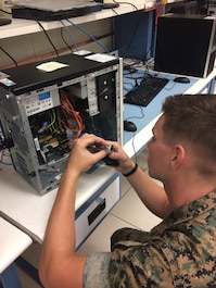 Private First Class Ethan T. Wampler is seen here trouble shooting a video card in the Data System Annex.  This is part of the training Marines receive within the Telephone System Computer System Repair Course as they identify broken component and execute the appropriate repairs. Private First Class Wamper will attain the MOS 2847 and greatly enhance the capabilities of his unit.