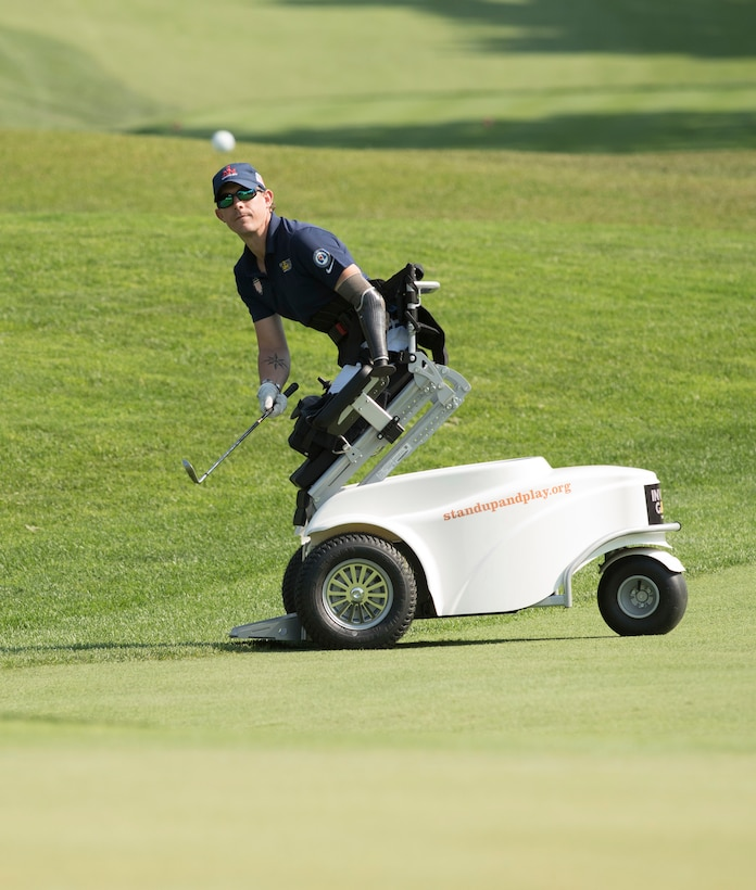Marine Corps veteran Sgt. Michael Nicholson competes in golf at St. George's Golf and Country Club during the 2017 Invictus Games.